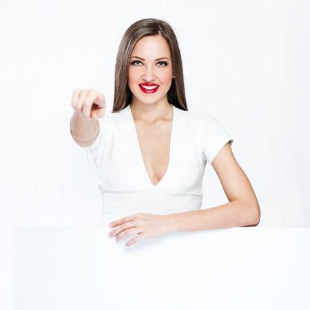 beautiful woman hold white blank board , blank paper photo