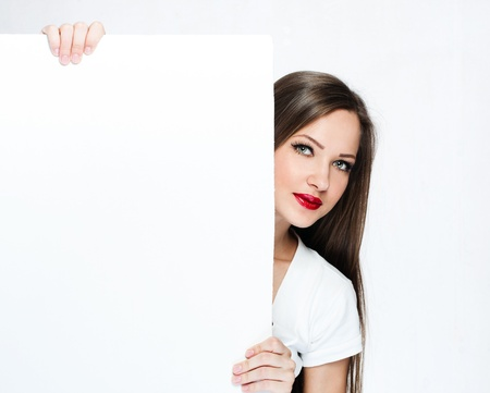 beautiful woman hold white blank board , blank paper Stock Photo