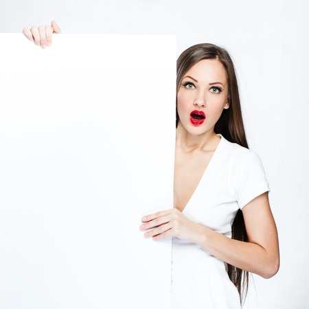 beautiful woman hold white blank board , blank paper photo