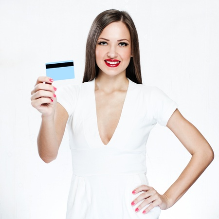 happy woman holding credit card Stock Photo - 18046370
