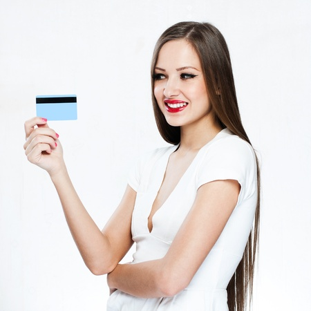 happy woman holding credit card Stock Photo - 18046497