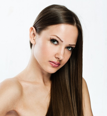 closeup portrait of a beautiful young woman with elegant long shiny hair photo