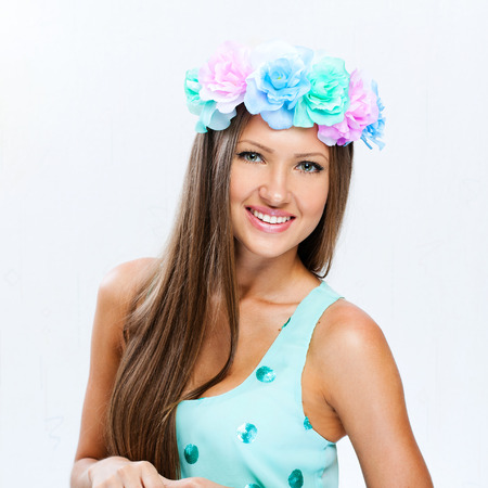 fashion model with hairstyle and flowers in her hair photo