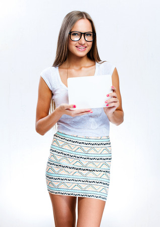 young smiling woman holding blank business card photo
