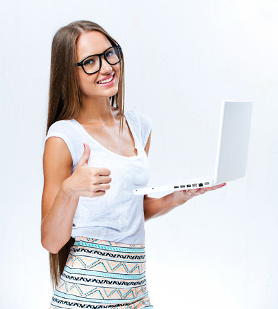 beautiful young woman holding laptop photo