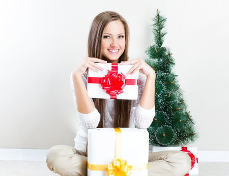 happy beautiful Christmas woman with Christmas gifts. photo