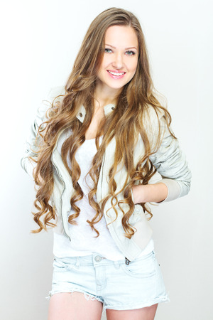 Beautiful young woman with long curly hairs photo