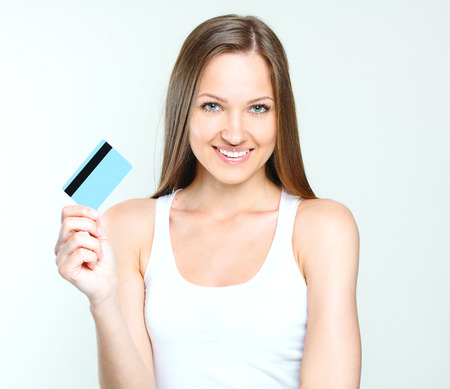 smiling attractive woman holding credit card. blank credit card. Stock Photo - 28215272