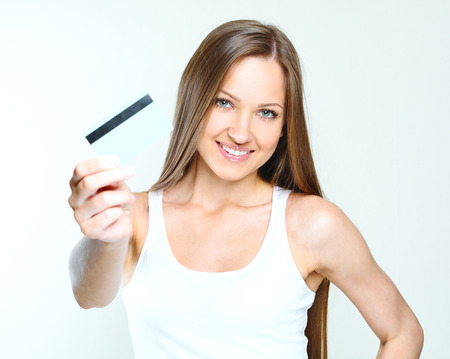 smiling attractive woman holding credit card. blank credit card. Stock Photo - 28215274