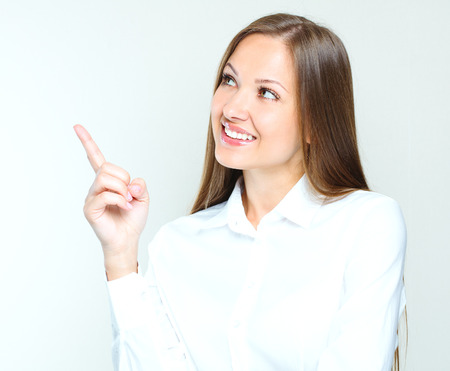succesful: attractive business woman poiting her hand at the blank copy space. succesful businesswoman.