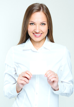 succesful woman: happy smiling succesful business woman holding blank credit visit card. beautiful woman. Stock Photo