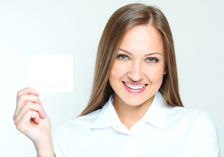 succesful: happy smiling succesful business woman holding blank credit visit card. beautiful woman. Stock Photo