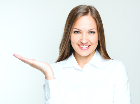 succesful woman: attractive business woman holding her hand with open palm. succesful businesswoman. Stock Photo