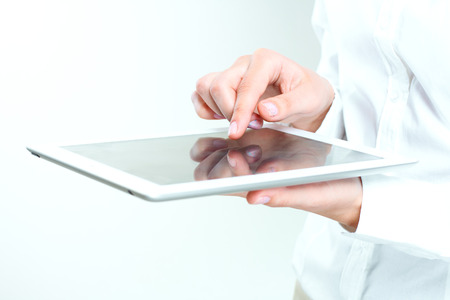 female hands holding tablet pc. Stock Photo