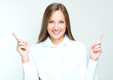 attractive business woman poiting her hand at the blank copy space. succesful businesswoman.