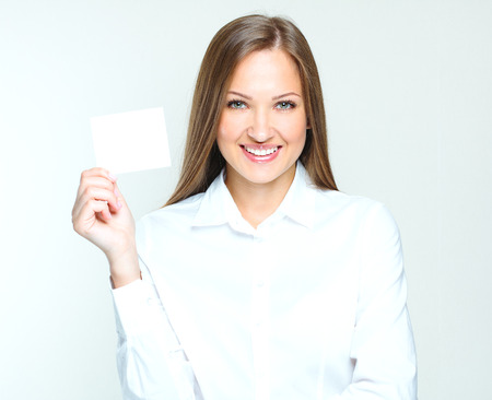 visit card: happy smiling successful business woman holding blank credit visit card. beautiful woman. Stock Photo