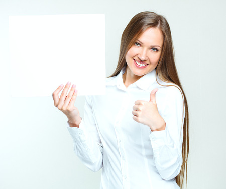 one sheet: portrait of a beautiful young happy business woman holding blank poster. empty copyspace for ads. business people.