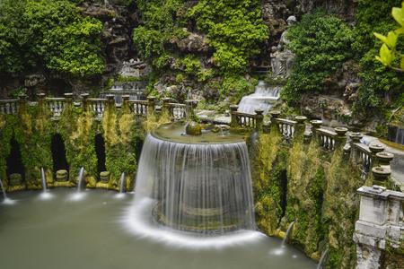 waterfall and garden of the villa of cardinal Ippolito d`Este, Tivoli, Italy.
