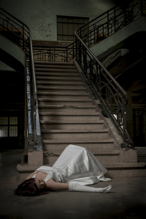 brides fallen down the stairs by accident and lies unconscious on the ground