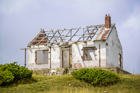 old abandoned and broken brick house without a roof