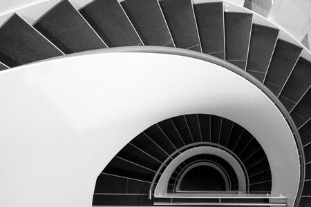 Spiral staircase in a modern building in black and white Stock fotó