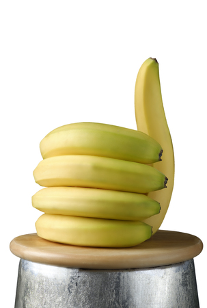Bananas in the shape of a hand with the thumb up, like healthy food concept Stok Fotoğraf