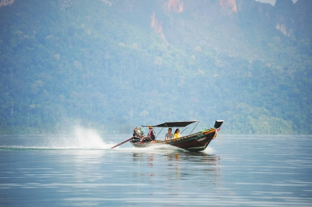 long tail Boat Travel in dam photo