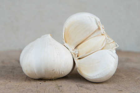 Closeup Garlic isolated on timber with Cement Background photo