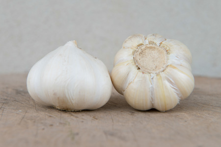 Garlic isolated set on timber with Cement Background photo
