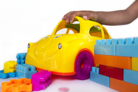 baby playing toy: concept baby playing colorful plastic car toy Stock Photo