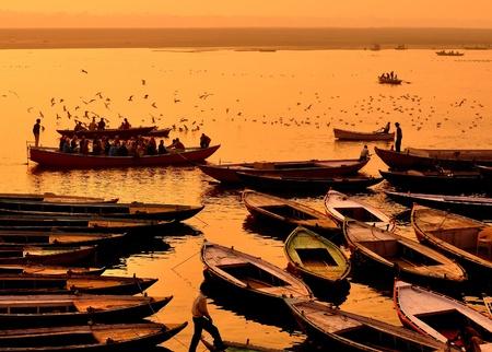 marina full of boats in Varanasi at sunset