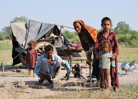 Khajuraho, India - November 26, 2009 - Poor family living in India in an old cart near Khajuraho