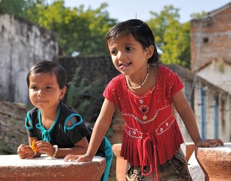 Khajuraho, India - November 27, 2009 - Two girls in real Indian village near Khajuraho