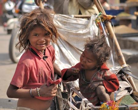 Jaipur, India - DECEMBER 01, 2009 - Poor siblings in the streets of Jaipur ask for money
