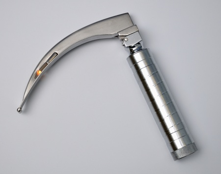 laryngoscope on gray background photo