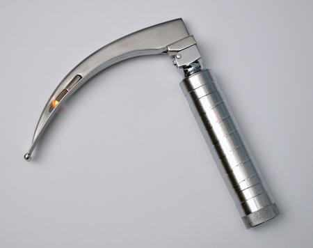 intubation: laryngoscope on gray background Stock Photo