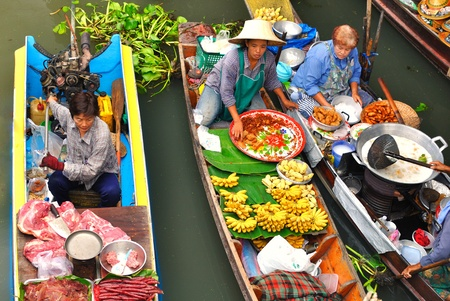 Damnoen Saduak, Thailand - March 07 2011 - Floating markets in Damnoen Saduak, Thailand. Until recently, the main form of trade, now mostly a tourist attraction.
