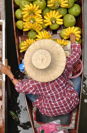 Fruit seller in Floating markets in Damnoen Saduak, Thailand.