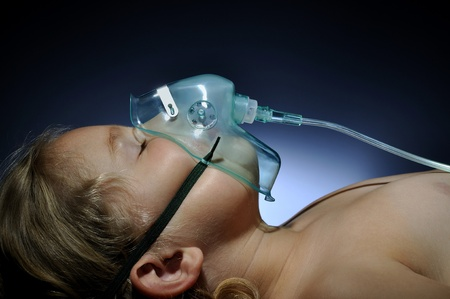 respiration: Little girl in mask oxygen. Stock Photo