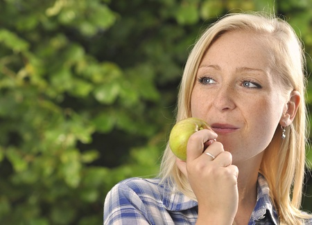 woman eating apple photo