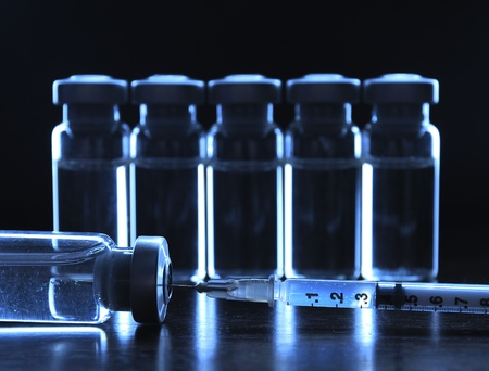 injected: Vials of medications. Dark blue.