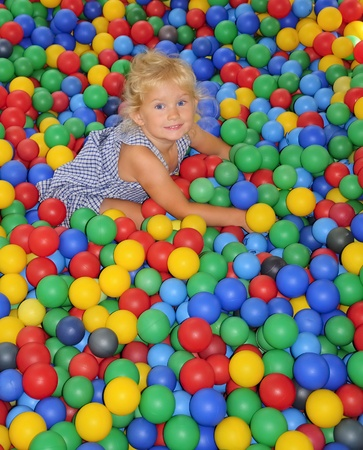 playcentre: Happy little girl playing in balls