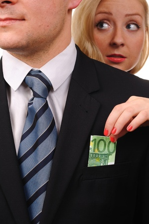 one hundred euro banknote: De euros en dinero en el bolsillo de traje Foto de archivo