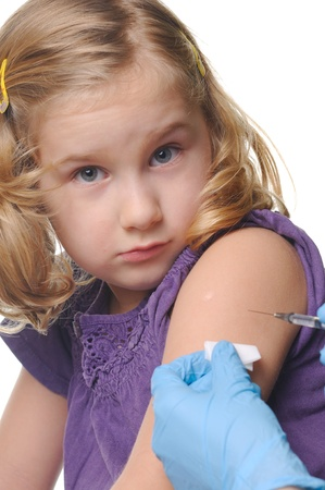 needle syringe infection: Child vaccinations on a white  Stock Photo