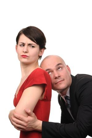 outrage: Man apologizes to woman isolated on white background  Stock Photo