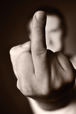 Middle finger as a sign of aggression  photo