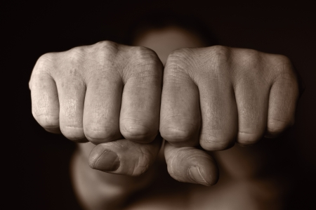 Two human fists as a symbol of aggression