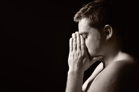 repentance: Praying man