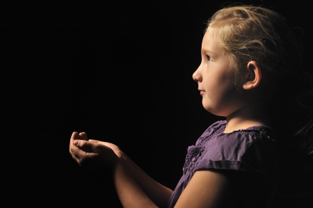 black gods: Little girl with empty hands ask    Stock Photo