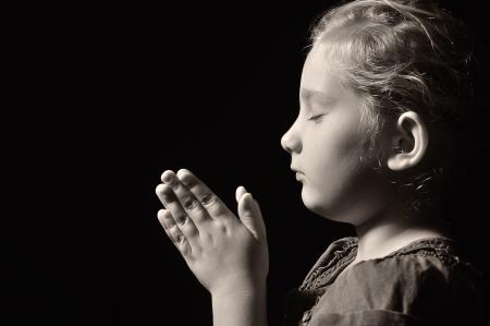 repentance: Praying child  Stock Photo